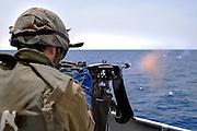 Israeli Navy missile boat class Saar 4.5 Soldier firing a machine gun