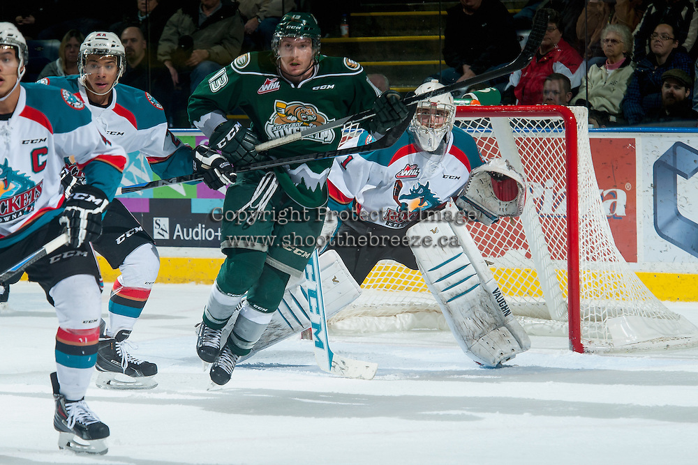 KELOWNA, CANADA - JANUARY 23: Remi Laurencelle #13 of Everett Silvertips looks for the pass in front of the net of Jackson Whistle #1 of Kelowna Rockets on January 23, 2015 at Prospera Place in Kelowna, British Columbia, Canada.  (Photo by Marissa Baecker/Shoot the Breeze)  *** Local Caption *** Jackson Whistle; Remi Laurencelle;