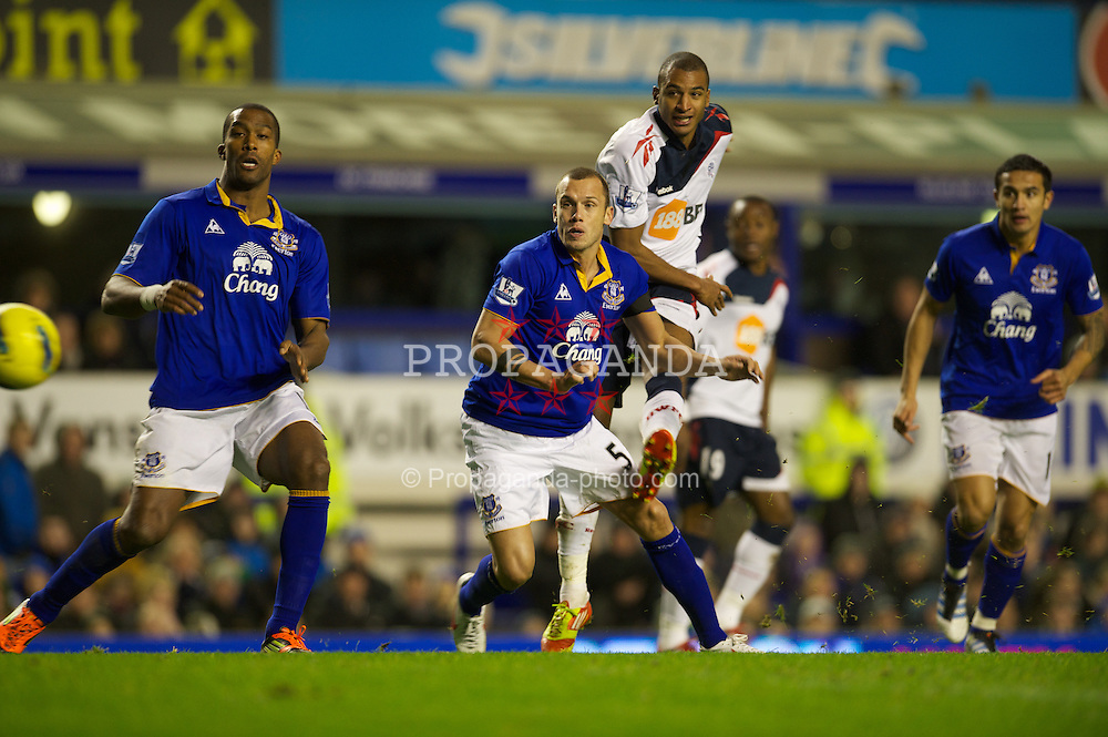 LIVERPOOL, ENGLAND - Wednesday, January 4, 2012: Bolton Wanderers' David Ngog scores the equalising first goal against Everton during the Premiership match at Goodison Park. (Pic by David Rawcliffe/Propaganda)