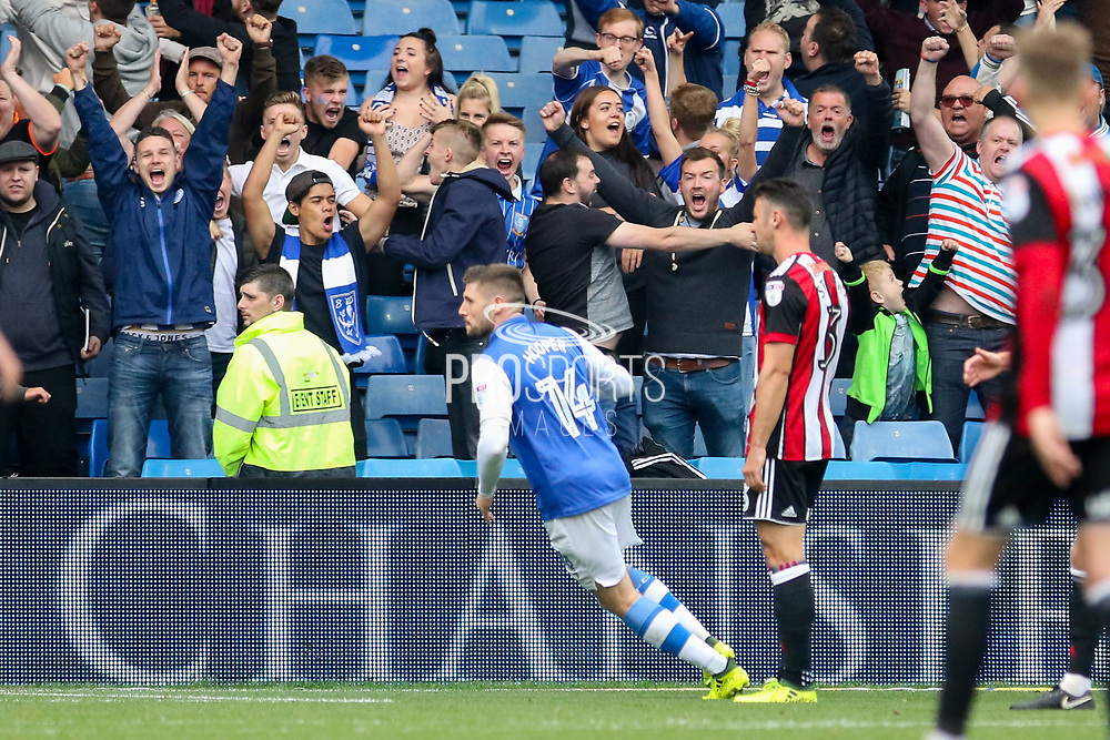 Sheffield Wednesday forward Gary Hooper (14) celebrates his goal 1-2 in front of the fans during the EFL Sky Bet Championship match between Sheffield Wednesday and Sheffield Utd at Hillsborough, Sheffield, England on 24 September 2017. Photo by Phil Duncan.