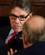 Energy Secretary Rick Perry listens to Trump administration official in the east Room of the White House on April, 3,2018<br /> Photo by Dennis Brack