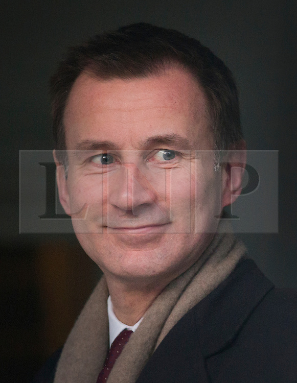 © Licensed to London News Pictures. 12/02/2016. London, UK. Health Secretary Jeremy Hunt leaves home. Yesterday it was announced that new contracts will be forced on junior doctors after they failed to reach agreement with the government.  Photo credit: Peter Macdiarmid/LNP