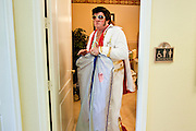 Aug. 2 - PHOENIX, AZ:  DONALD TRAPANI, dressed as Elvis Presley, comes of a restroom before performing at the Stratford, a Phoenix Alzheimer's care facility. Trapani, 68, was diagnosed with lung cancer in August 2009 and entered the care of Hospice of the Valley, the largest hospice organization in Phoenix, shortly after that. His doctor said he would be dead by the end of February 2010. Trapani is in still in the care of Hospice of the Valley, but his condition has improved. He now entertains other hospice patients singing the songs of Elvis Presley. He tries to hold one concert each week, his health permitting, at different hospice units in the Phoenix area.     Photo by Jack Kurtz