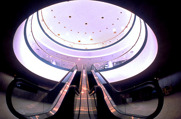 Architectural Detail of Escalator and Circular Cutout in Floor