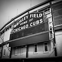 Chicago Cubs Wrigley Field sign in black and white. Wrigley Field is home of the Chicago Cubs and was built in 1914 making it one of the oldest baseball stadiums in the United States.