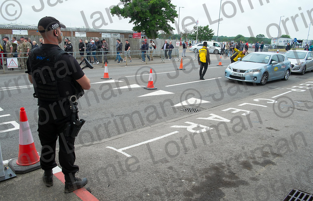 The 2017 Formula 1 Rolex British Grand Prix at Silverstone Circuit, Northamptonshire.<br /> <br /> Pictured: An armed police officer stands guard at the main entrance to Silverstone Circuit.<br /> <br /> Jamie Lorriman<br /> mail@jamielorriman.co.uk<br /> www.jamielorriman.co.uk<br /> +44 7718 900288
