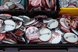 © Licensed to London News Pictures . 22/09/2019. Brighton, UK. Badges in support of Jeremy Corbyn and Chris Williamson being sold by the entrance of the conference centre during the second day of the 2019 Labour Party Conference from the Brighton Centre . Photo credit: Joel Goodman/LNP