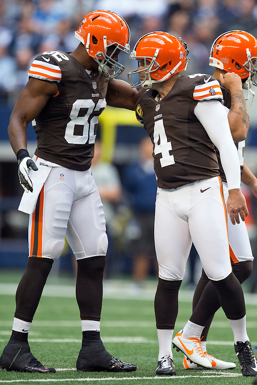 ARLINGTON, TX - NOVEMBER 18:  Phil Dawson #4 is congratulated by Benjamin Watson #82 of the Cleveland Browns after kicking a extra point against the Dallas Cowboys at Cowboys Stadium on November 18, 2012 in Arlington, Texas.  The Cowboys defeated the Browns 23-20.  (Photo by Wesley Hitt/Getty Images) *** Local Caption *** Phil Dawson; Benjamin Watson