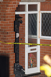 © Licensed to London News Pictures . 10/12/2013 . Bolton , UK . The scene outside 123 Albert Road West in Bolton today (10th December 2013) where three people died following a fire , yesterday morning (9th December 2013) . Police believe the fire was started deliberatively by architect Hassan Rafie , killing himself and his wife Mahnaz . Another woman staying in the house at the time , believed to be Mrs Rafie's mother , later died of injuries sustained in the fire , in hospital . Photo credit : Joel Goodman/LNP