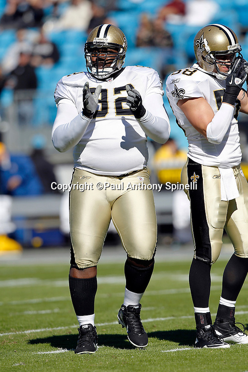 New Orleans Saints defensive tackle Remi Ayodele (92) claps while getting set for the next play during the NFL week 9 NFL football game against the Carolina Panthers on Sunday, November 7, 2010 in Charlotte, North Carolina. The Saints won the game 34-3. ©Paul Anthony Spinelli