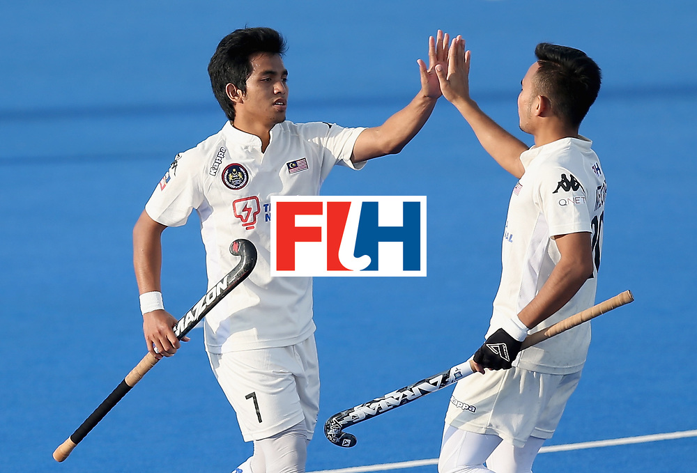 LONDON, ENGLAND - JUNE 20:  Fitri Saari of Malaysia celebrates scoring his sides fifth goal with Azuan Hasan of Malaysia during the Pool A match between China and Malaysia on day six of the Hero Hockey World League Semi-Final at Lee Valley Hockey and Tennis Centre on June 20, 2017 in London, England.  (Photo by Alex Morton/Getty Images)