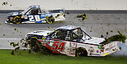Kansas City Racing Sports Photographer- Natalie Decker (54) spins into the infield grass during the NASCAR Truck Series auto race at Kansas Speedway in Kansas City, Kan., Friday, May 10, 2019. Harrison Burton (20) gets by on the outside. AP Photo Colin E. Braley