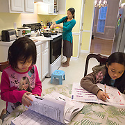 "Atlanta, Georgia/Burma Refugee/Klaw Htoo makes dinner for her daughters Gloria (4) and Sophia (8), at their home in Atlanta, while the girls do their homework. Klaw and her family were forced to flee Burma (also known as Myanmar) and they lived in an refugee camp in Thailand for nine years. Klaw arrived in the U.S. in 2007 alone with her oldest daughter, she was pregnant with Gloria. Her husband was not able to join her, and today he is still living in a camp in Thailand while he waits to be reunited with his family in the U.S. The IRC in Atlanta provided Klaw and her girls with a place to live and helped Klaw learn English, and find daycare so she could work. Eventually Klaw was hired as a case aide with the IRC in Atlanta. ?I liked to share my story with them and I interacted with the clients. I would give them details on how to live in the U.S.,? said Klaw. ""Life in America is tough but better than in my country because if I compare there is no way to have a good education in my country. Here there are lot of resources, for myself and my kids, we can get a good education. You have freedom and everything."" After two years of working for the IRC, Klaw went to work at Emory University and the DeKalb County Department of Health to do tuberculosis screenings and provide education to the public. ?It is such a big opportunity for me to work for them,? she said. Klaw became a U.S. citizen on January 28, 2013. /UNHCR/E.Hockstein/February 2013."