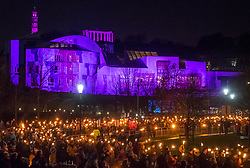 Edinburgh, Scotland,United Kingdom. 30 December, 2017.  Torchlight Procession which forms one part of Edinburgh's Hogmanay celebrations. pIctured; Procession passes in front of the Scottish Parliament building.