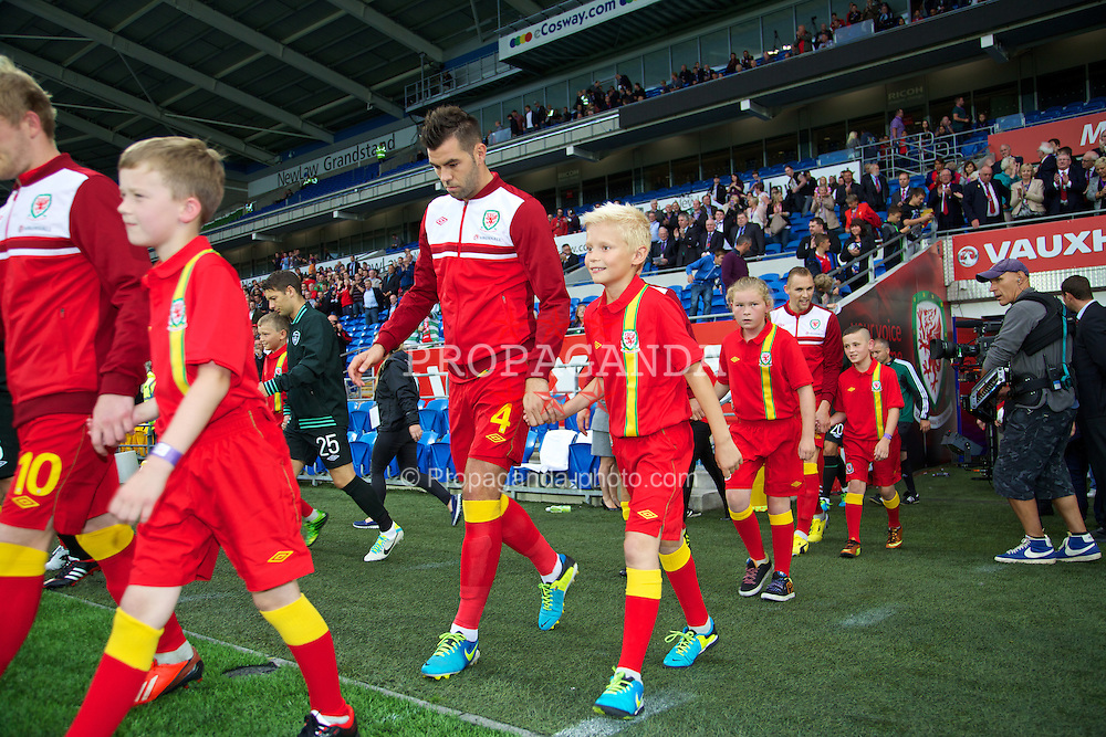 CARDIFF, WALES - Wednesday, August 14, 2013: Wales' Joe Ledley walks out to face Republic of Ireland during an International Friendly at the Cardiff City Stadium. (Pic by David Rawcliffe/Propaganda)