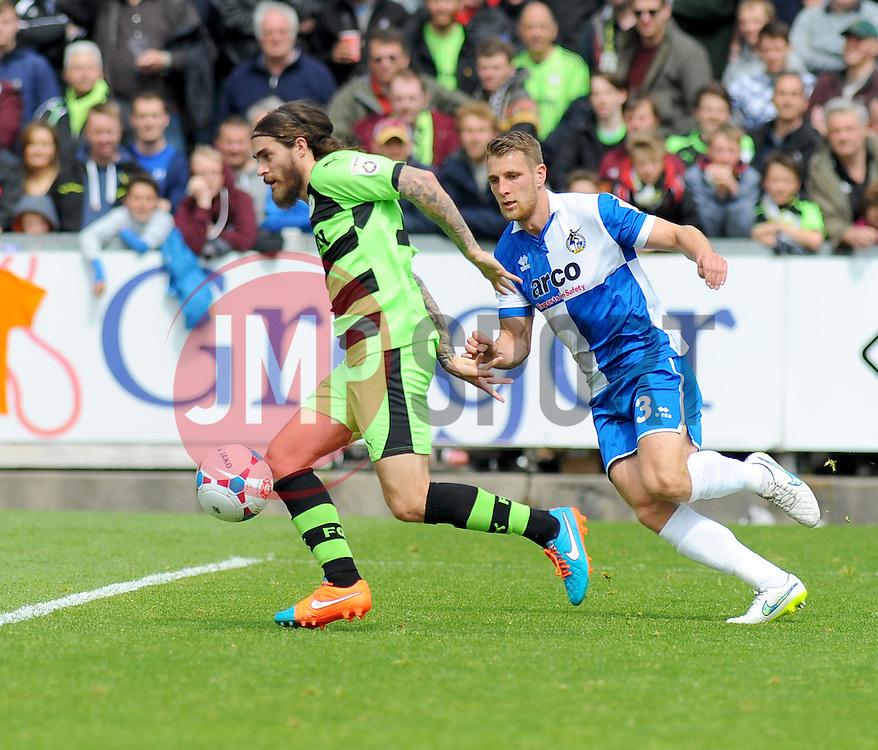 Bristol Rovers' Lee Brown chases Forest Green Rovers's Rob Sinclair for the ball. - Photo mandatory by-line: Nizaam Jones /JMP - Mobile: 07966 386802 - 03/05/2015 - SPORT - Football - Bristol - Memorial Stadium - Bristol Rovers v Forest Green Rovers - Vanarama Football Conference.