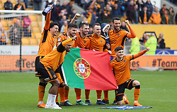 The Portuguese contingent of Wolverhampton Wanderers players celebrate winning promotion to the Premier League after the Sky Bet Championship match at Molineux, Wolverhampton.