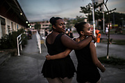 Isabel Sande and Isabela Peixoto  head to the library they are using as their training centre  in Manguinhos neighbourhood in Rio de Janeiro, Brazil, Monday, June 11, 2018. The Manguinhos community ballet has been a reprieve from the violence and poverty that afflicts its namesake neighborhood for hundreds of girls who have benefitted from free dance classes since 2012. (Dado Galdieri for The New York Times)