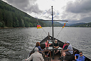 tourists on a cruise boat Titisee is a lake in the southern Black Forest in Baden-Württemberg, Grmany. It covers an area of 1.3 km2 (320 acres) and is an average of 20 m (66 ft) deep