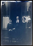 family in front of ground floor space France circa 1930s