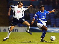 Photo: Chris Ratcliffe.<br />Ipswich Town v Portsmouth. The FA Cup. 07/01/2006.<br />Matthew Taylor (L) of Portsmouth is beaten by Fabian Wilnis of Ipswich.