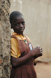 Ghana, Accra, Kokomlemle, 2007. At the back gates of Kwameh Nkrumah Memorial School, a student waits for her classmates to arrive.
