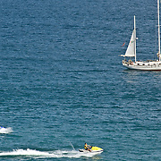 Sailboat and wave runners in Cabo San Lucas bay. Cabo San Lucas,BCS.Mexico.