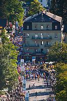 Interlaken, Berner Oberland, Switzerland. Runners of the Jungfrau Marathon in the streets of Interlaken.
