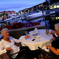 NAPLES, FL - January 23, 2010 -- Sandy Chenard, left, of Manotick, Ontario, and her friend Mary Ann Zeppetello, of Syracuse, New York, have drinks on a Marina-side view at Olio restaurant, part of the Naples Bay Resort, in Naples, Fla., on Saturday, January 23, 2010.