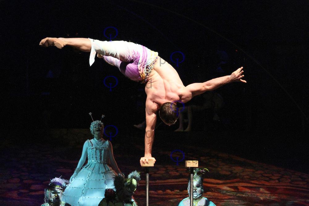 Hand Balancing; Denys Tolstov, Cirque Du Soleil Alegria opening night, O² Arena, London UK, 18 July 2013, (Photo by Richard Goldschmidt)