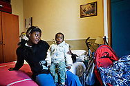 Napoli, Italia - 11 dicembre 2010. Rasmata Zabsonre fotografata insieme a suo figlio nella sua stanza/casa all'interno dell'hotel Vergiulius di Napoli..Ph. Roberto Salomone Ag. Controluce.ITALY - Rasmata Zabsonre in her room/house in Vergilius hotel in Naples on December 11, 2010.