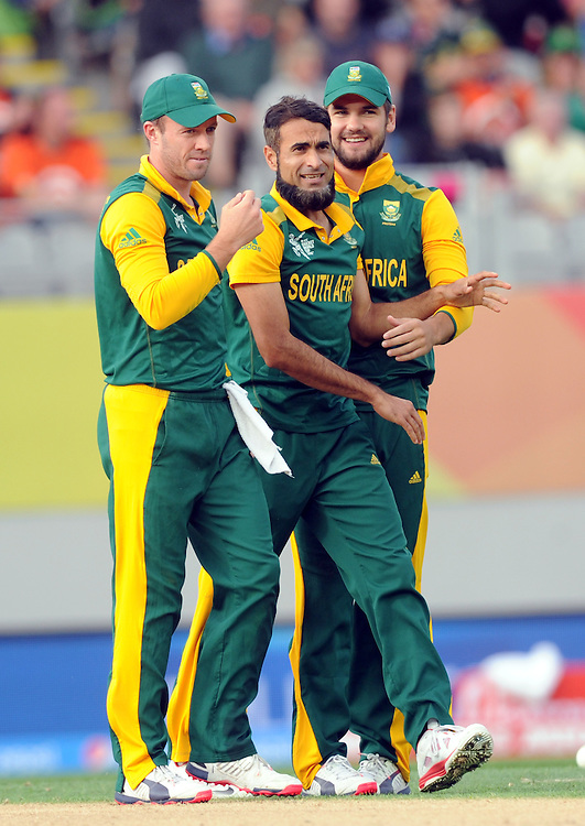 South Africa's Muhammad Imran Tahir, centre, after dismissing Pakistan's Wahab Riaz lbw for 0 in the ICC Cricket World Cup at Eden Park, Auckland, New Zealand, Saturday, March 07, 2015. Credit:SNPA / Ross Setford