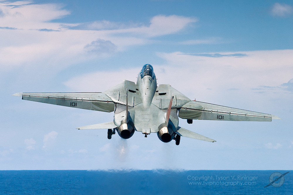 AJ101, an F-14 Tomcat from VF-31 'Tomcatters', launches off the deck of the USS Theodore Roosevelt CVN-71 during sea trials prior to their 2005 Mediterranean deployment. This would be the final cruise for the F-14 Tomcat and the last time it would ever see combat.