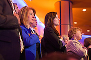 "22 FEBRUARY 2012 - MESA, AZ:      Attendees say the Pledge of Allegiance at the Arizona Republican Presidential Debate in the Mesa Arts Center in Mesa, AZ, Wednesday. It is the last debate before the Michigan and Arizona Republican primaries on Feb. 28 and ""Super Tuesday"" on March 6.   PHOTO BY JACK KURTZ"