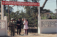 Ross Perot shakes hands with North Vietnamese official in Vientiane, Laos on December 29, 1969..Photograph by Dennis Brack BBBs 20