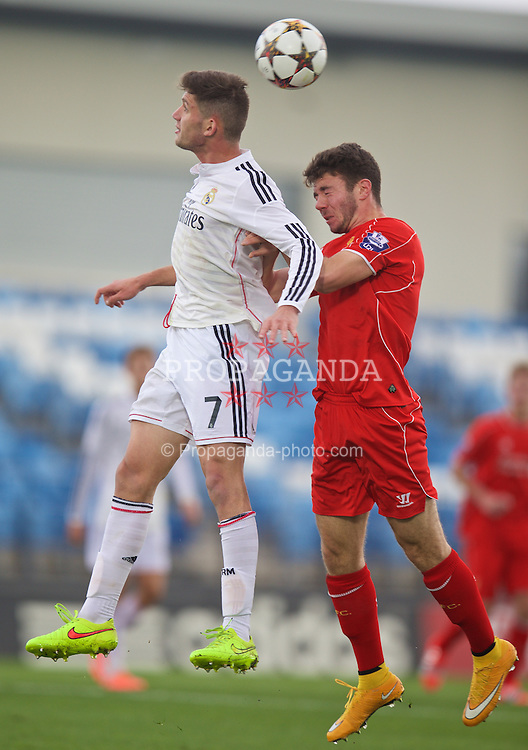 MADRID, SPAIN - Tuesday, November 4, 2014: Liverpool's Joe Maguire in action against Real Madrid CF's Jose Carlos Lazo during the UEFA Youth League Group B match at Ciudad Real Madrid. (Pic by David Rawcliffe/Propaganda)