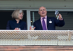 Image ©Licensed to i-Images Picture Agency. 19/07/2014. , United Kingdom. Home Secretary Theresa May attends Newbury races and joined Ian Duncan Smith on the balcony Newbury ,Berkshire Picture by i-Images