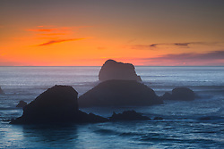 """Plaskett Rock at Sunset 2"" - Photograph at sunset of Plaskett Rock and other rocks along the Pacific Ocean shoreline in the Big Sur area of California."