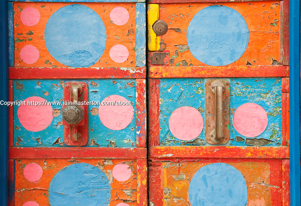 Colourful door on  house in village of Burano near Venice in Italy