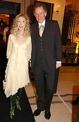 RICHARD & BASIA BRIGGS at a reception for the winners of the 2006 Veuve Clicquot Award - Business Woman of the Year held at Claridge's Hotel, brook Street, London on 27th April 2006.  This years winner was Vivienne Cox, BP CEO for Gas, Power, Renewables and Integrated Supply & Trading.  The awards were presented by the Rt.Hon.Gordon Brown MP - The Chancellor of the Exchequer.<br />