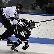 Jeff Taylor, Union College, (right) is challenged by Frankie DiChiara, Yale, during the Yale Vs Union College, Men's College Ice Hockey game at Ingalls Rink, New Haven, Connecticut, USA. 28th February 2014. Photo Tim Clayton