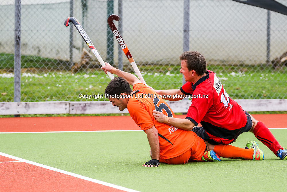Midlands Nick Ross and Canterbury's Angus Hazlett tussle for the ball. Midlands v Canterbury Men, FORD National Hockey League, ITM Hockey Centre, Whangarei, New Zealand. Friday 16 September, 2016. Copyright photo: Heath Johnson / www.photosport.nz