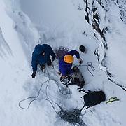Róbert Halldórsson and Freyr Ingi Björnsson preparing to climb Íste WI 4, at Múlafjall, Hvalfjörður, Iceland.