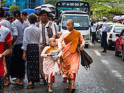 09 NOVEMBER 2015 - YANGON, MYANMAR:  Buddhist nuns walk through the crowd up the street in front of NLD headquaters. Thousands of National League for Democracy (NLD) supporters gathered at NLD headquarters on Shwegondaing Road in central Yangon to celebrate their apparent landslide victory in Myanmar's national elections that took place Sunday. The announcement of official results was delayed repeatedly Monday, but early reports are that the NLD did very well against the incumbent USDP.    PHOTO BY JACK KURTZ