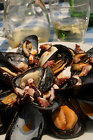 Mussels at a harbor restaurant in Naples - photograph by Owen Franken
