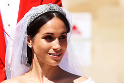 Meghan Markle rides in an Ascot Landau carriage after her wedding to Prince Harry at St. George's Chapel in Windsor Castle.
