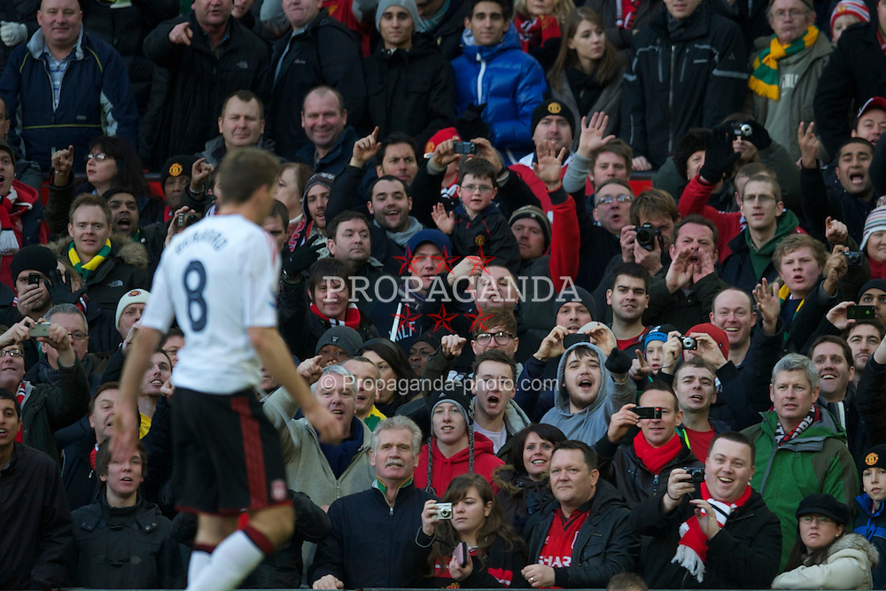 MANCHESTER, ENGLAND - Sunday, January 9, 2011: Liverpool's captain Steven Gerrard MBE leaves the field after being shown the red card, and sent off by referee Howard Webb during the FA Cup 3rd Round match against Manchester United at Old Trafford. (Photo by: David Rawcliffe/Propaganda)