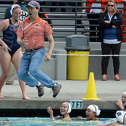 Pasadena Poly head Ryan Katsuyama jumps in the pool after defeating Ocean View 10-4 to win the Division 6 Championship water polo match at William Woollett Jr. Aquatics Center in Irvine, Calif., on Saturday, February 28, 2015.
