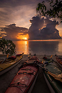 Raja Ampat, West Papua, Indonesia, December 2016. Sunrise at Yenanas Paradise home stay on the island of Gam. Thousands of small islands fringed by coral reefs and blue water mangroves litter the Raja Ampat archipelago. The turquoise and blue waters are teeming with marine life that forms the livelihood for the local Papuan population. Kayak4conservation is the Raja Ampat Research & Conservation Centre (RARCC) project that supports the locals to develop a community based, sustainable tourism project, inviting visitors to explore their islands by sea kayak with a local guide and experience the culture by staying amongst the local people in traditional style homestays. Photo by Frits Meyst / MeystPhoto.com