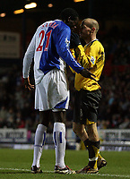 Photo: Paul Thomas.<br /> Blackburn Rovers v Arsenal. The FA Cup. 28/02/2007.<br /> <br /> Arsenal's Freddy Ljundberg (R) tries to tell Christopher Samba what the ball looks like.